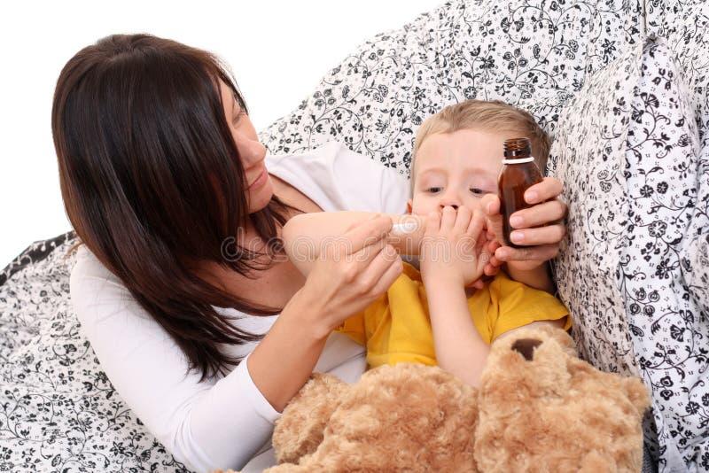 Criança e xarope fotos de stock