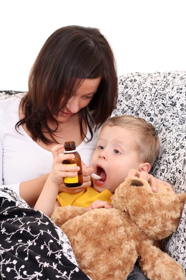 Criança e xarope imagem de stock