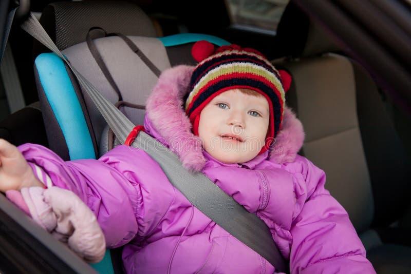 Criança em um carro fotos de stock