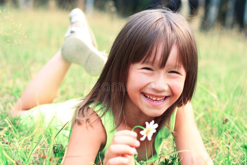 A criança está sorrindo fotografia de stock royalty free