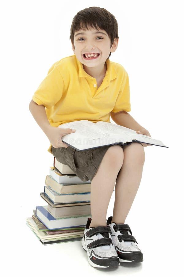 Criança Excited do menino com livros fotografia de stock
