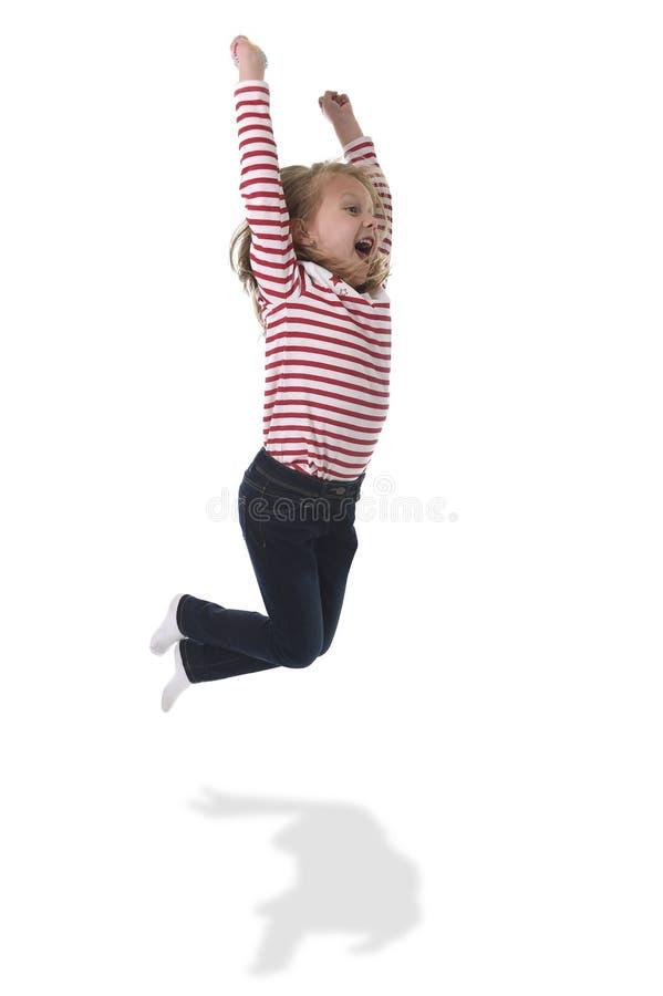 A criança fêmea com o cabelo louro que salta a aumentação feliz e louca arma-se no conceito da educação de linguagem corporal imagem de stock royalty free
