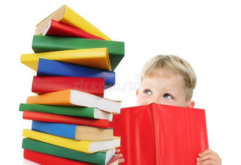 Criança feliz com livros imagem de stock royalty free