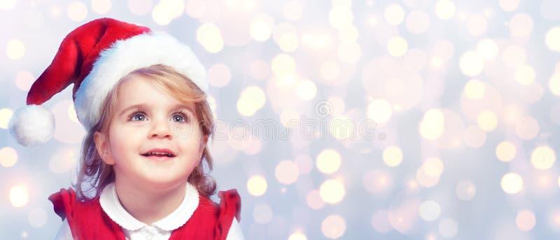 Criança feliz e bonito com Santa Hat fotografia de stock royalty free