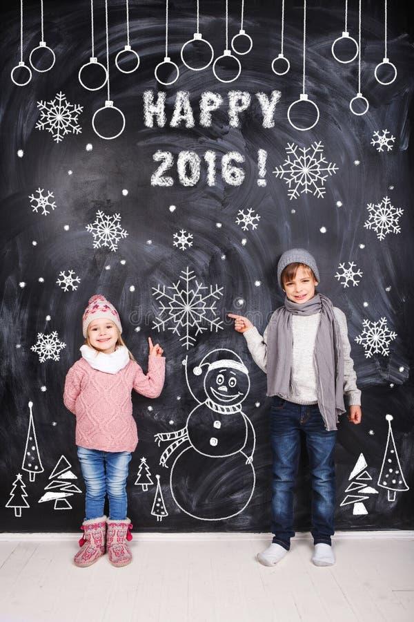 Criança feliz e 2016 feliz imagens de stock royalty free