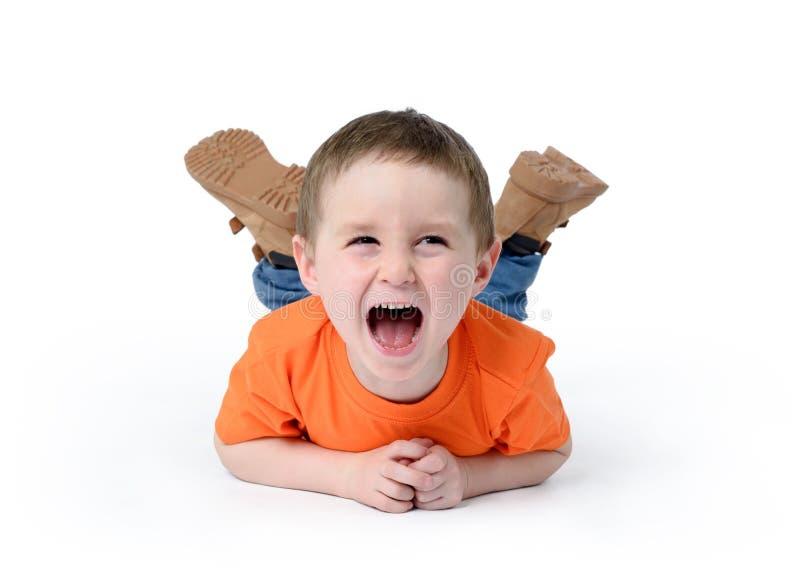Criança feliz que ri no fundo branco imagem de stock royalty free