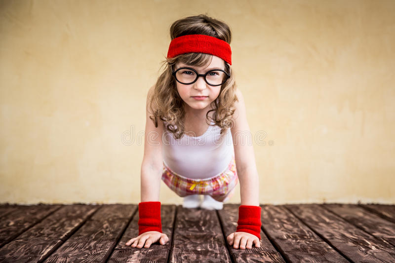 Criança forte engraçada imagens de stock