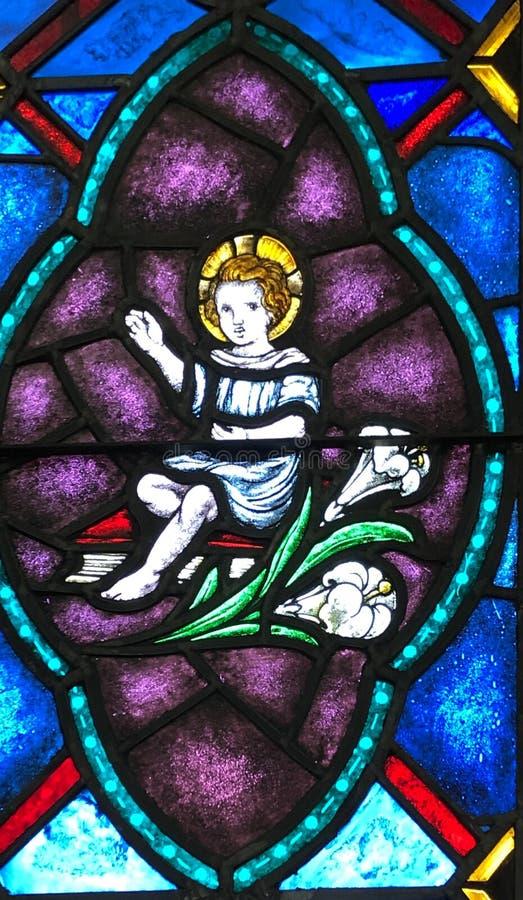 A criança Jesus, a Bíblia, e Lillies fotos de stock