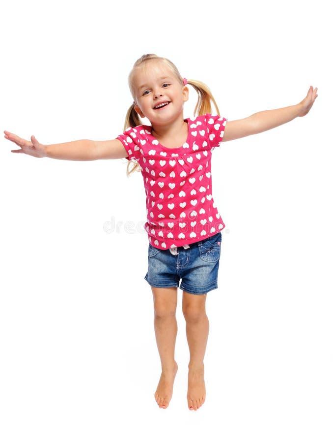Criança loura de salto fotos de stock
