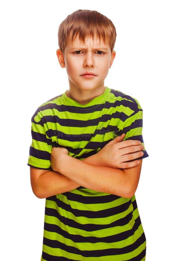 Criança loura escura má agitada irritada em um listrado fotos de stock