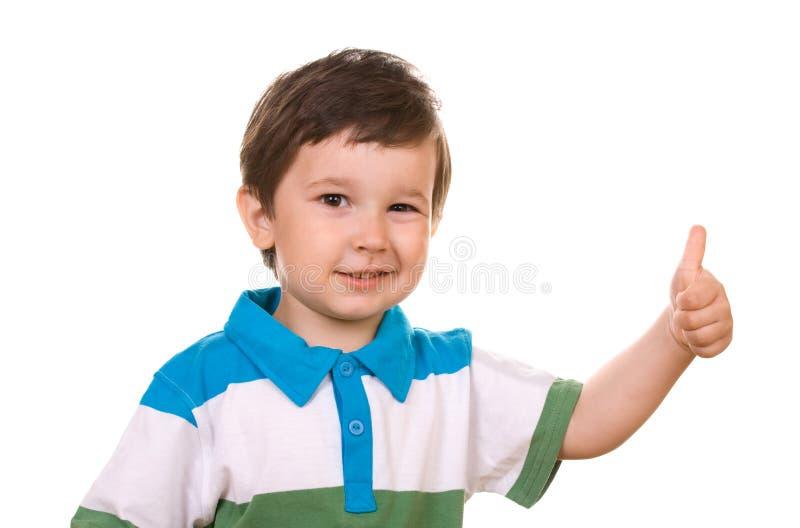 A criança mostra o sinal da APROVAÇÃO fotos de stock royalty free