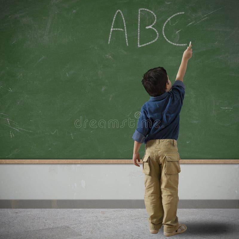 Criança na escola imagens de stock royalty free