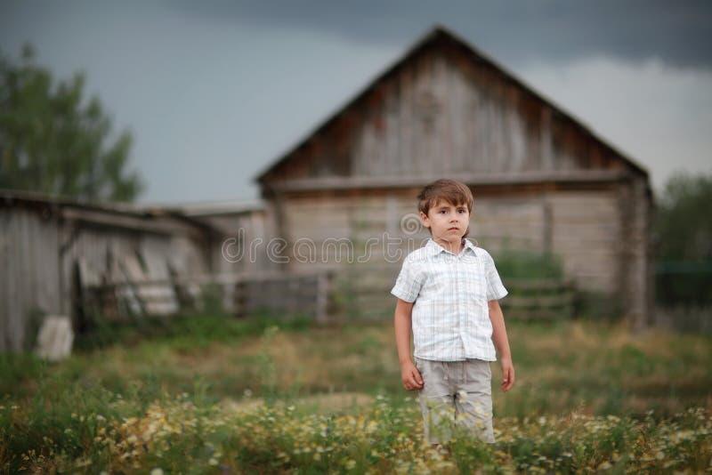 Criança na vila imagens de stock royalty free