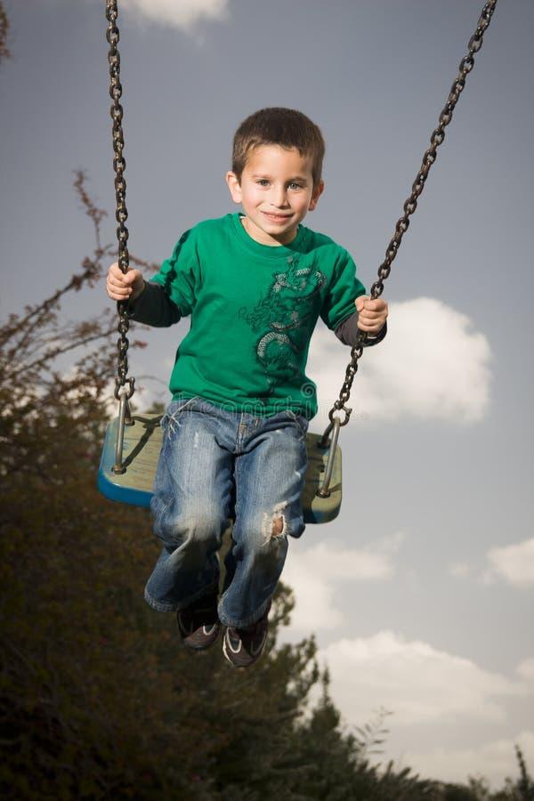 Criança no balanço fotos de stock royalty free