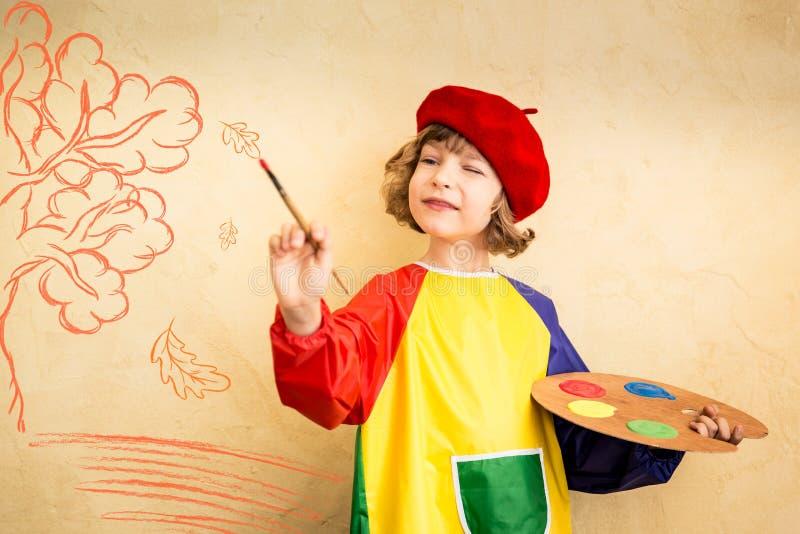 Criança no outono imagens de stock royalty free
