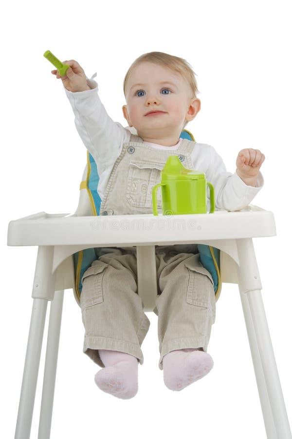 Criança no tamborete da criança. imagem de stock