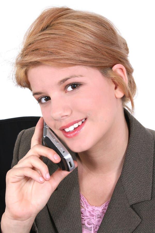 Criança no terno desgastando do telemóvel imagem de stock
