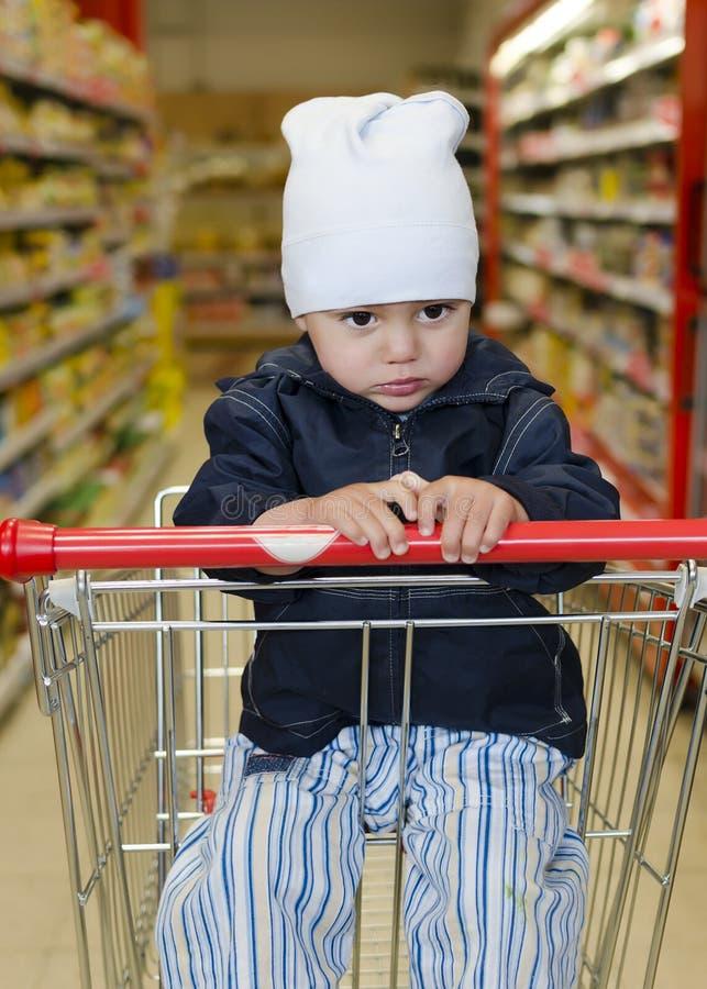 Criança No Trole Da Compra Fotos de Stock Royalty Free