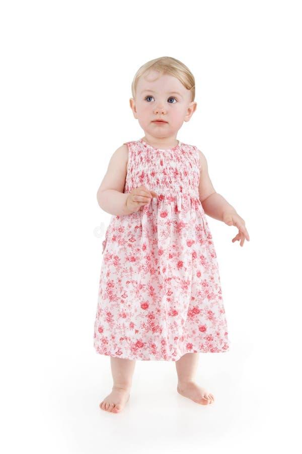 Criança no vestido florescido foto de stock royalty free