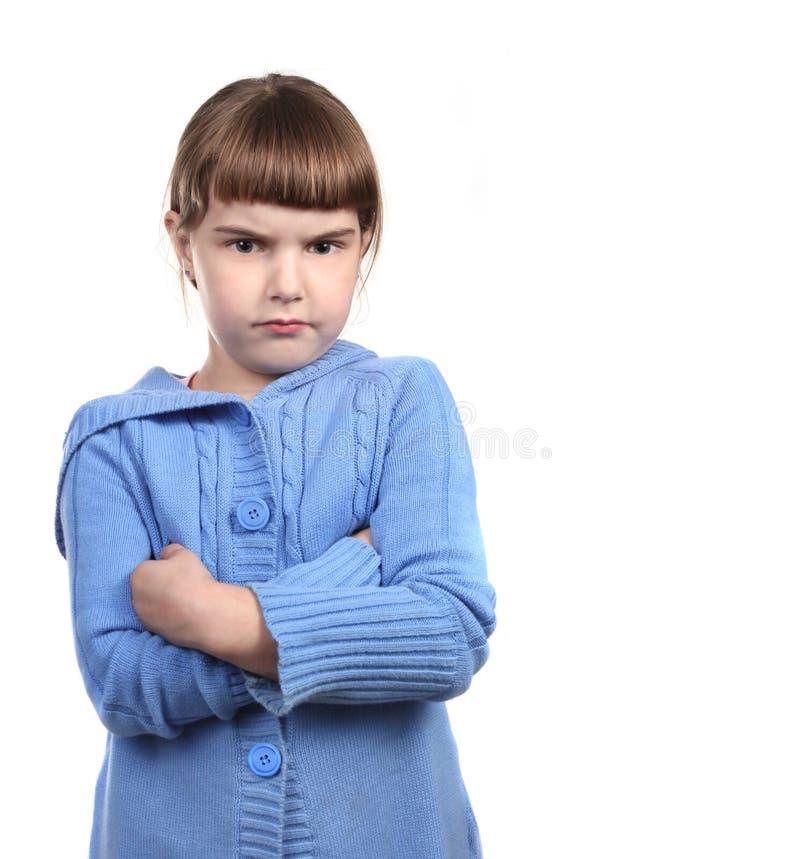 Criança nova desafiante com os braços cruzados imagem de stock