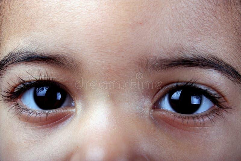 Criança? olhos de s foto de stock