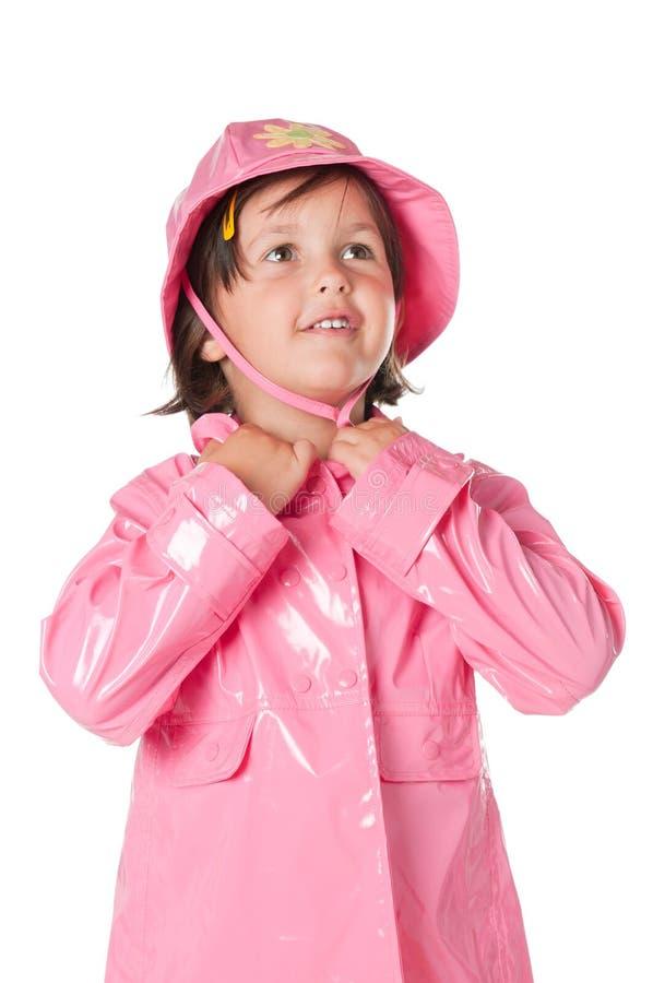 Criança pequena com raincoat fotografia de stock