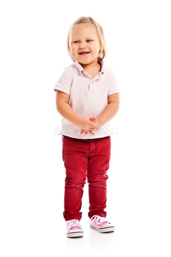 Criança pequena feliz que levanta no estúdio fotografia de stock royalty free