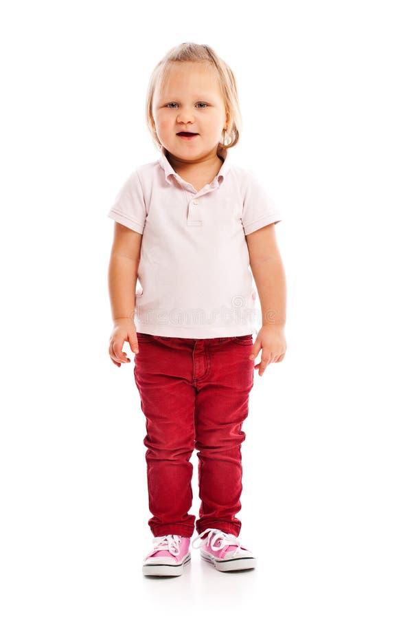 Criança pequena feliz que levanta no estúdio imagem de stock royalty free
