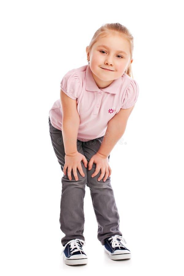 Criança pequena feliz que levanta no estúdio imagens de stock royalty free