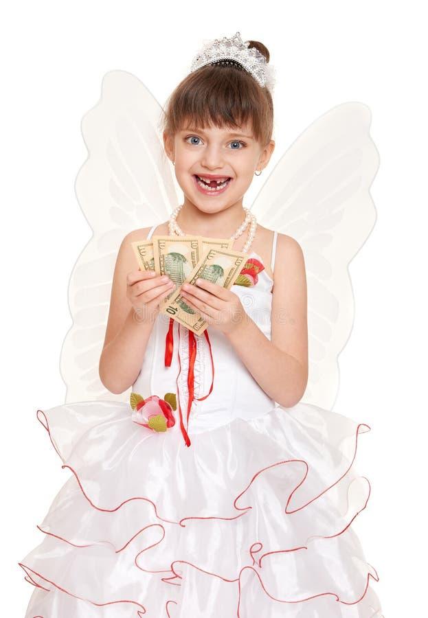 Criança perdida do dente vestida como a fada de dente com presentes e dinheiro fotografia de stock