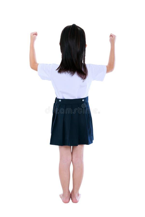 Criança pré-escolar no uniforme com suas mãos acima no estúdio Isolado imagem de stock royalty free