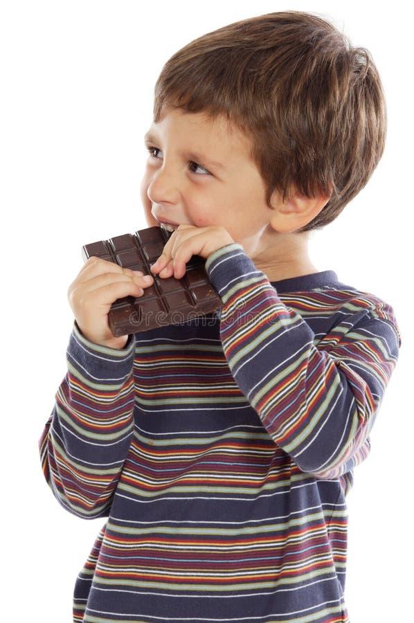 Criança que come o chocolate fotografia de stock