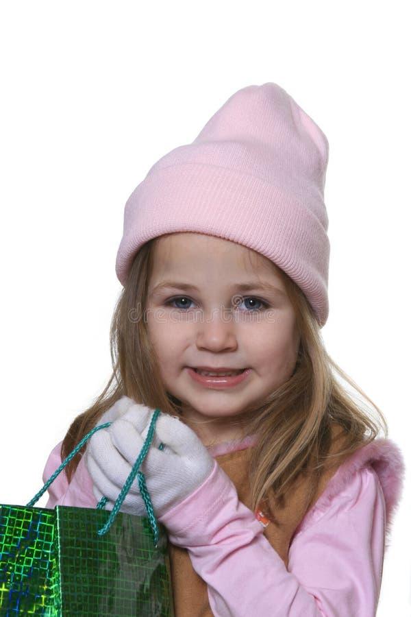 Criança que dá o presente do Natal imagens de stock