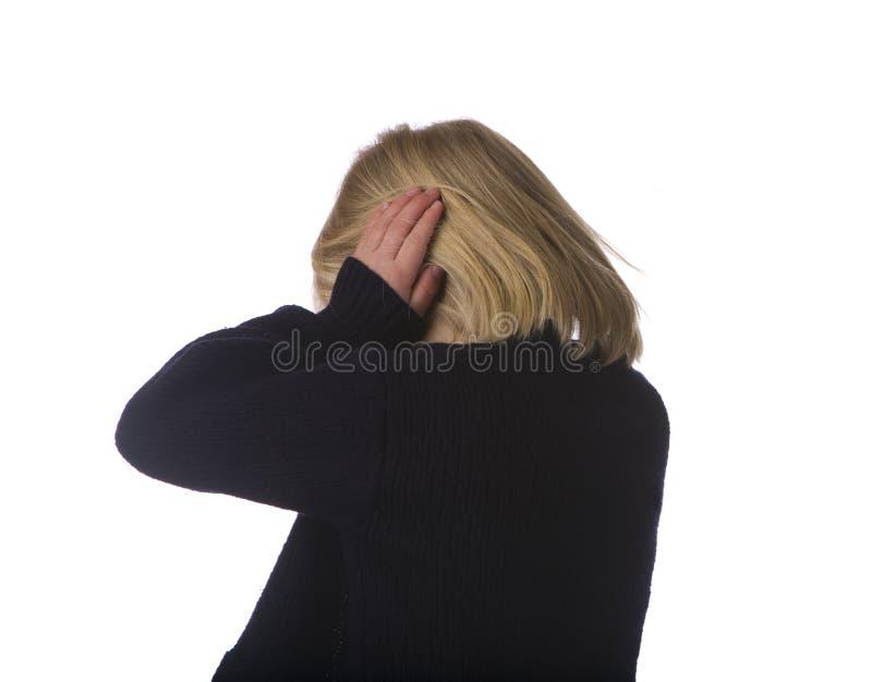 Criança que gira afastado e que cobre as orelhas imagens de stock