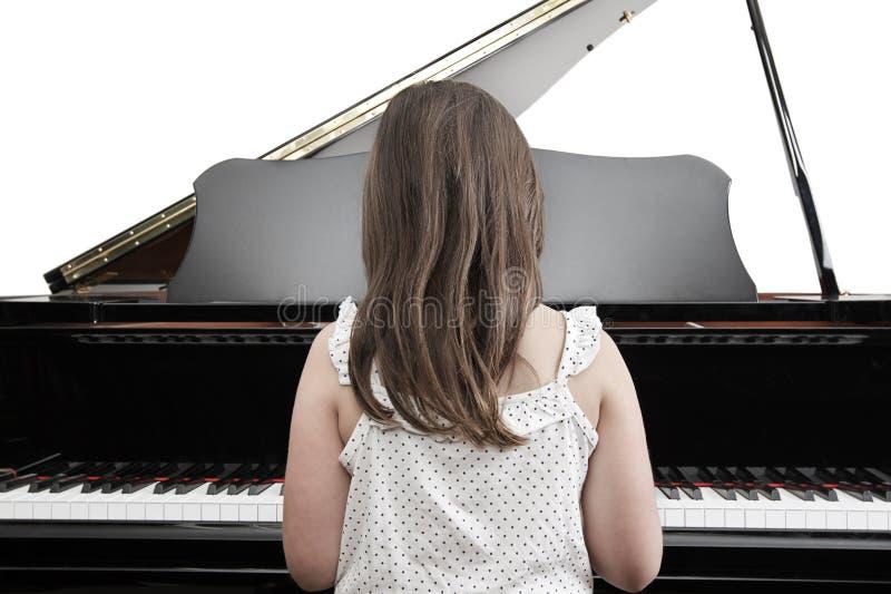 Criança que joga o piano foto de stock royalty free