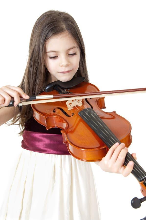 Criança que joga o violino fotografia de stock