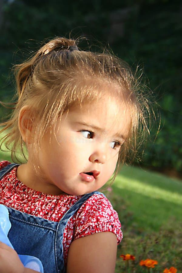 Criança que olha afastado fotos de stock royalty free