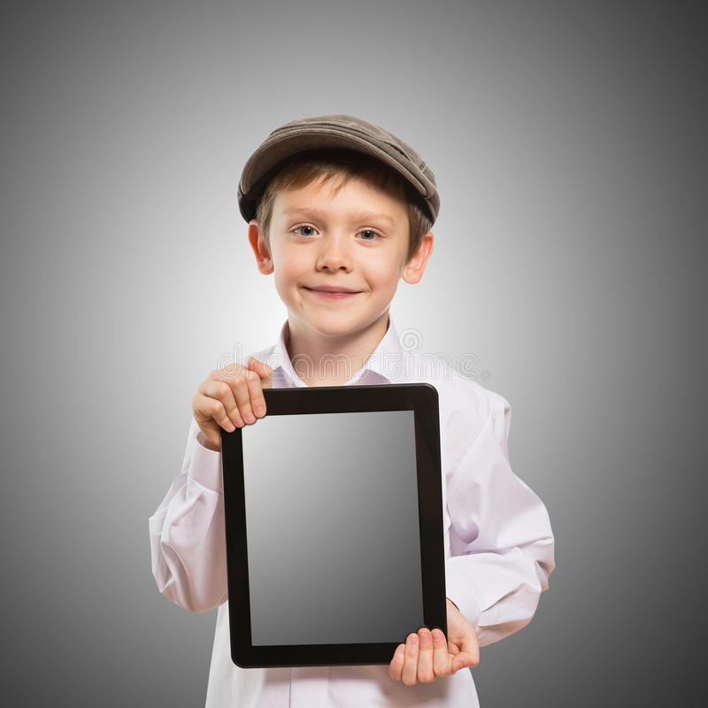 Criança que usa um PC da tabuleta fotos de stock royalty free