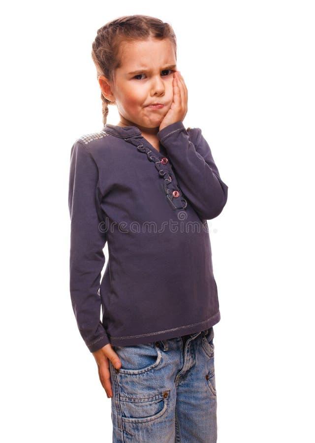 A criança tem a menina pouca dor de dente, emoções grandes foto de stock royalty free