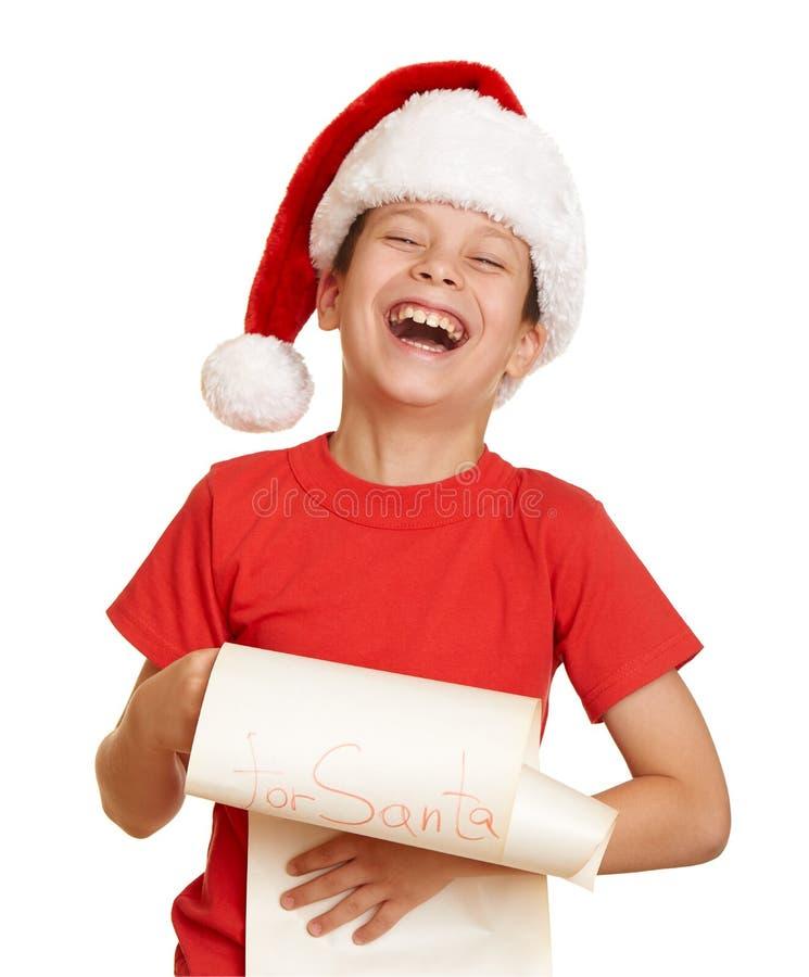 A criança vestiu-se no chapéu de Santa com a letra isolada no fundo branco Véspera de ano novo e conceito do feriado de inverno imagem de stock royalty free