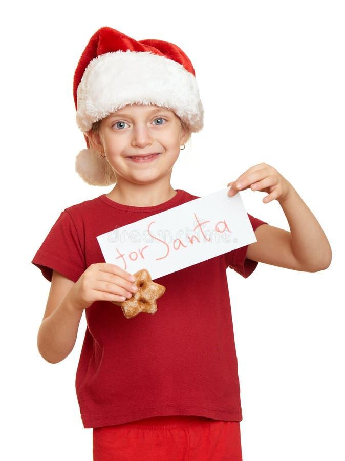 A criança vestiu-se no chapéu de Santa isolado no fundo branco Véspera de ano novo e conceito do feriado de inverno imagens de stock royalty free