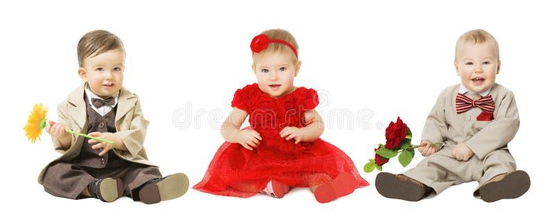 Crianças bem vestidos, crianças elegantes dos bebês com flor, forma foto de stock royalty free