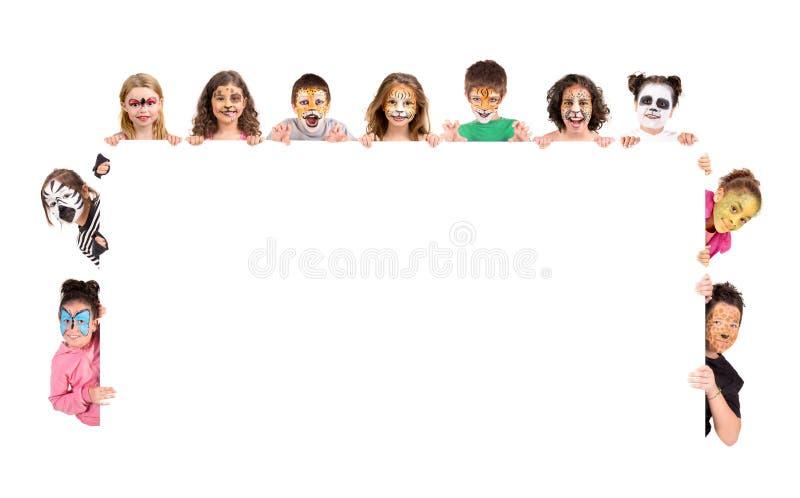 Crianças com cara-pintura animal imagens de stock royalty free