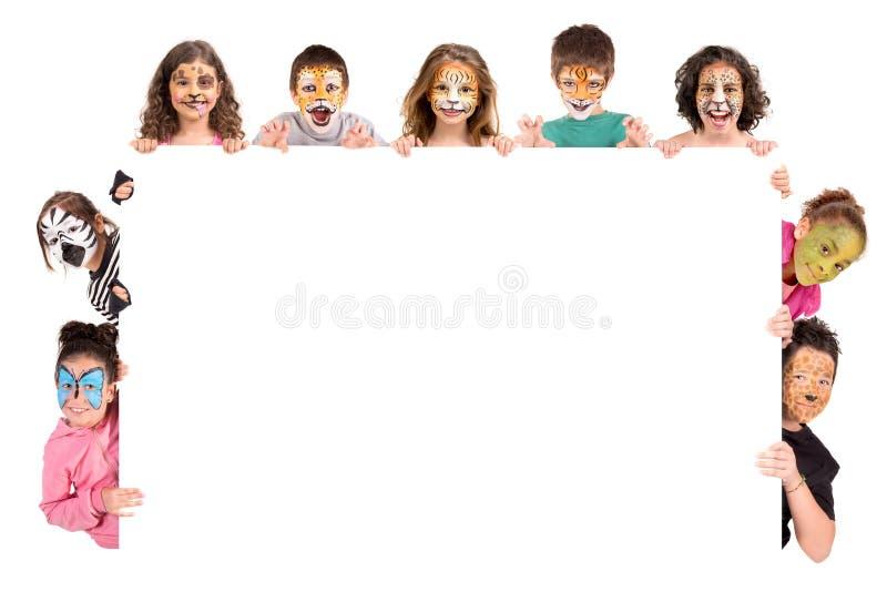 Crianças com cara-pintura animal fotografia de stock