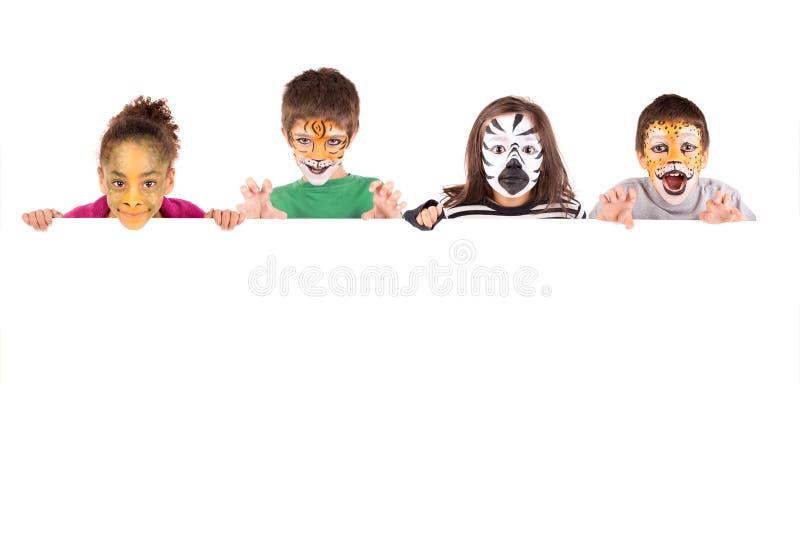 Crianças com cara-pintura animal fotos de stock royalty free