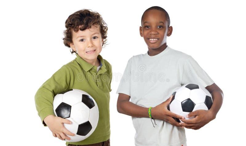 Crianças com esfera de futebol imagem de stock royalty free