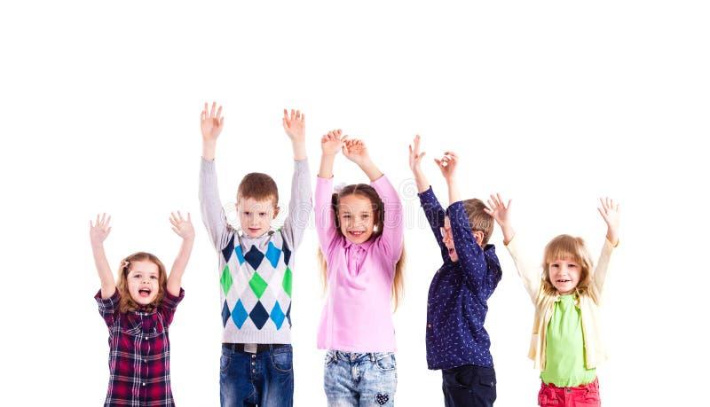 Crianças com mãos levantadas fotos de stock