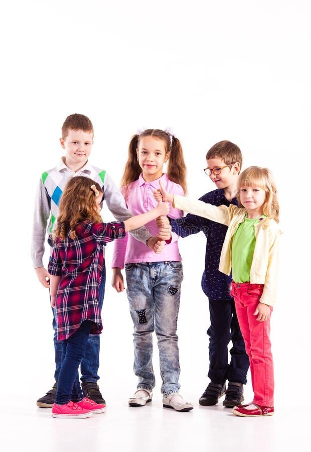 Crianças com mãos levantadas fotos de stock royalty free