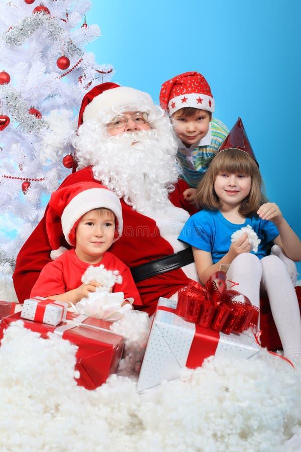 Crianças com Santa foto de stock royalty free
