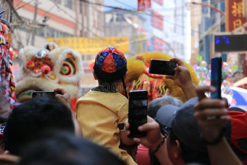 Crianças em Binondo, Manila comemorando o ano novo chinês fotos de stock royalty free